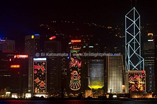 Hong Kong skyline at night as seen from the Star Ferry Terminal at Tsim Sha Tsui, Kowloon, Hong Kong, China, Asia