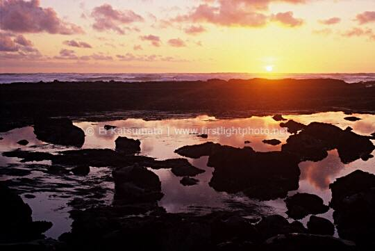 The sun sets over the tidepools at Fitzgerald Marine Reserve in Moss Beach, San Mateo County coast, California, United States of America