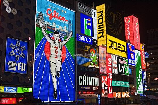 Brightly lit signs light up the Dotonbori canal district at night, Osaka, Kansai Region, Japan